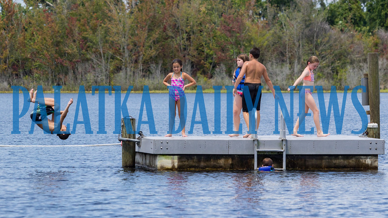 Children cool off during their last week of summer vacation at T. Alonzo Middleton Beach on Lake Broward in Pomona Park on Monday afternoon. Fran Ruchalski/Palatka Daily News