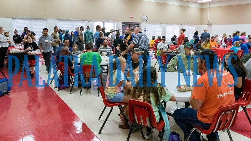 Dads who brought their kids to C.H. Price Middle School in Interlachen on Wednesday morning were treated to breakfast with them for Breakfast With Dad. Over 200 people participated in the event. Fran Ruchalski/Palatka Daily News