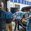 Police Chief Jason Shaw tosses a pillow to Captain Matt Newcomb as they finish filling a police van with donated items for the Bahamas while Mayor Terrill Hill and Lieutenant Scott Reinhold standby. Fran Ruchalski/Palatka Daily News