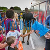 To prepare the kids for going back to school, firefighters handed out book bags and supplies at the Moseley Celebration on Tuesday night. Fran Ruchalski/Palatka Daily News