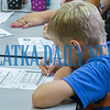 Fifth-grader Michael May, 10, fills out a form on the necessary attributes to consider when choosing a career. Fran Ruchalski/Palatka Daily News