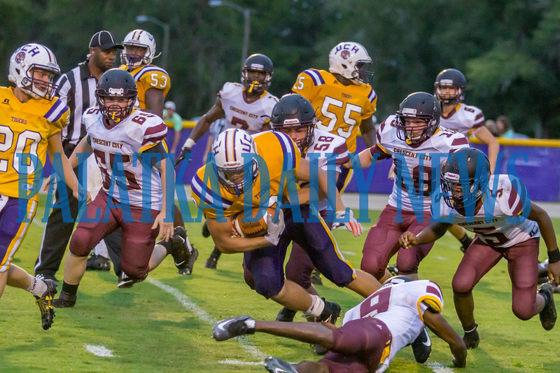 Crescent City senior Kaleb Young (58) wraps up a Tigers ball carrier in the second quarter in the game against Union County on Friday night in a preseason matchup. Fran Ruchalski/Palatka Daily News