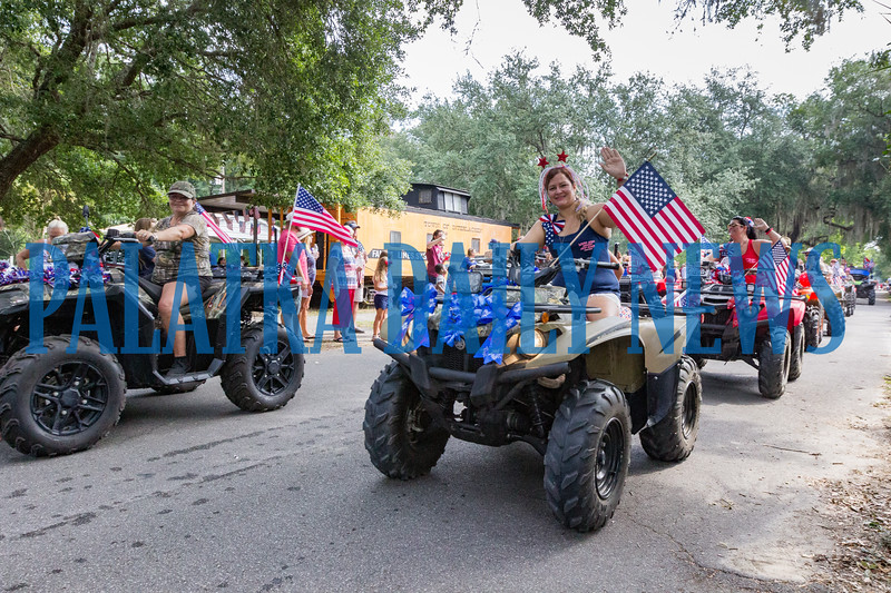 The Lake Area Riderz atv club drive in the Independence Day parade through the streets of Interlachen. Fran Ruchalski/Palatka Daily News