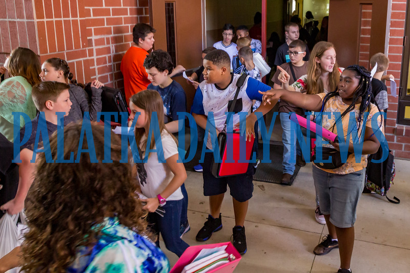 The new class of sixth-graders at C. H. Price Middle School try to navigate to their first period classes at their new school with maps and a little help from their friends. Fran Ruchalski/Palatka Daily News