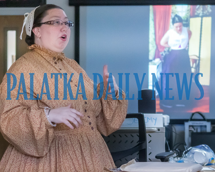 Mischa Johns, Putnam County Archivist, talks about what it takes to dress in period costumes and dresses in the Living History Workshop she is conducting at local libraries for people who want to reenact history. Fran Ruchalski/Palatka Daily News
