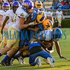 Several Panthers defenders combine to bring down Menendez quarterback King Benford (11) in the first half of their game on Friday night. Fran Ruchalski/Palatka Daily News