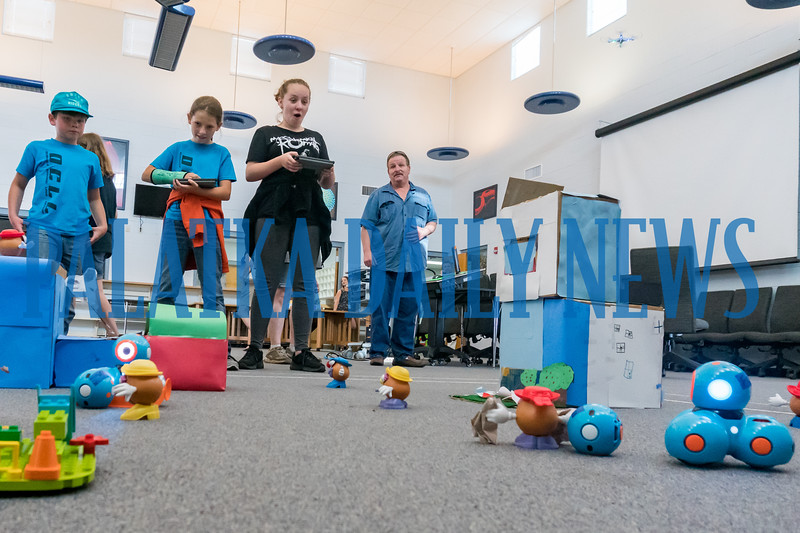 While Isaiah Joyce, 11, looks on, Angel Tyre, 10, and Khandi Tyre, 13, use police robots  to round up criminal balls in potato town without endangering any citizens and take them to jail. The game was conducted by third-grade-teacher Nikki Hutchinson of Ochwilla Elementary School. <br /> The Putnam County School District hosted a STEM Carnival at the PCSD Training Center on Thursday afternoon. Students demonstrated their projects with robots, drones, coding and software, competing for prizes in a friendly competition. The idea is to spark interest in Science, Technology, Engineering and Mathematics in kids, making the learning fun and preparing them for technology careers in the future. Fran Ruchalski/Palatka Daily News