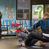 Jiu-Jitsu instructor Ben Goodrich watches as his eleven-year-old student Peirce Browning demonstrates how he takes down Joe Theobold who is twice his size during a presentation at the Palatka Library on Friday afternoon. Fran Ruchalski/Palatka Daily News