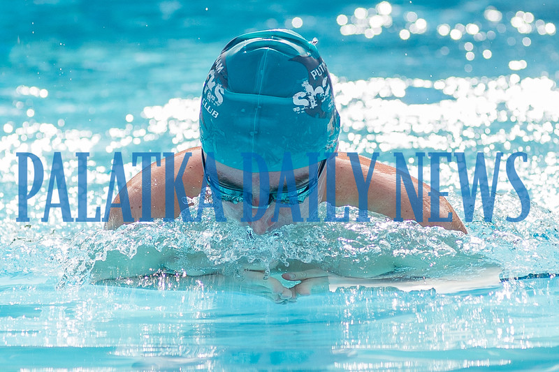Brady Weaver swims the breast stroke during the 100 Yard Individual Medley.