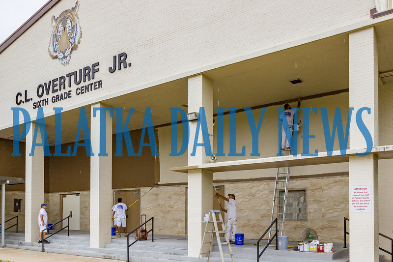 C. L. Overturf Sixth Grade Center is in the midst of getting a major makeover. An Allnu painting crew updates the exterior of the building after new tile has been installed over the lower portion of the front wall. Fran Ruchalski/Palatka Daily News