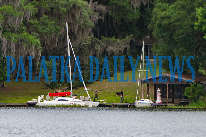 Putnam County Sheriff's Dept. deputies investigate the scene of the drowning of a two-year-old in Melrose Bay on Thursday morning. Fran Ruchalski/Palatka Daily News