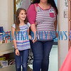 Clarissa Lyons, 8, escorts her mom, Mary Lyons into Ms. Greene's class for the Mother's Day celebration at Interlachen Elementary School on Friday morning. Fran Ruchalski/Palatka Daily News