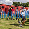 Crescent City Raiders coach XXX demonstrates how he wants his defenders to hit the tackling dummies at practice on Tuesday afternoon. Fran Ruchalski/Palatka Daily News