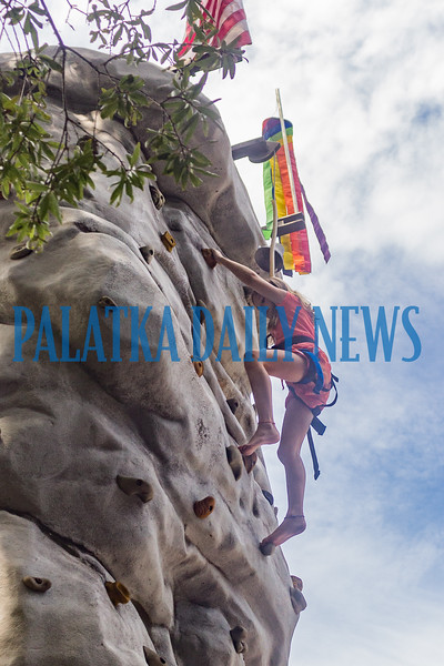 Nine-year-old Blake McKinney scales the rock-climbing wall at the Independence Day Celebration in Interlachen. Fran Ruchalski/Palatka Daily News