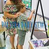 Hayden Kilburn, 7, shows his mom, Jessica Kilburn his photo that is framed with his original artwork in Ms. Greene's class for the Mother's Day celebration at Interlachen Elementary School on Friday morning. Fran Ruchalski/Palatka Daily News