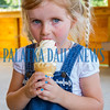 Three-year-old Natalie Rife enjoys the first soft serve ice cream to be served at Hallie's Landing on Friday evening. Fran Ruchalski/Palatka Daily News