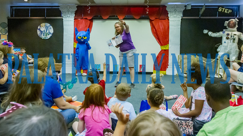 Pete the Cat stands in the front of the room while Robin Robinson reads one of his books to the children that gathered to see him at Toddler Fest at the Putnam County Headquarters Library on Saturday morning. About 700 people attended the second annual event this year. Fran Ruchalski/Palatka Daily News