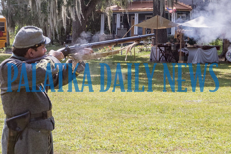 Confederate army officer Keith Kohl fires his weapon at Occupation Palatka on Friday morning. Fran Ruchalski/Palatka Daily News