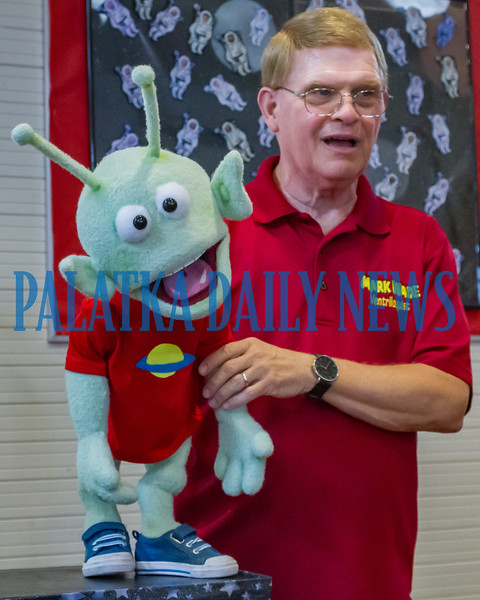 Ventriloquist Mark Wade introduces alien GLORP to the crowd during their performance at the Bostwick Library on Friday afternoon. He and his friends will be performing on Saturday at the Crescent City Library and at the ones in Interlachen and Melrose on Wednesday. Fran Ruchalski/Palatka Daily News