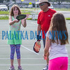 Under the tutelage of Randy Curtis, Alyson Dahlquist, 9, hits the pickleball to partner Kayda Gaylord, 10 during the Youth Pickleball Introductory Clinic at the John Theobold Sports Complex on Thursday morning. The clinic was one of several events Putnam County Parks & Recreation organized to celebrate Park and Recreation Month. Fran Ruchalski/Palatka Daily News