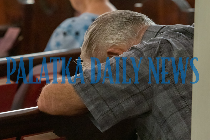 An attendee deep in prayer as the 9/11 prayer gathering comes to a close. Fran Ruchalski/Palatka Daily News