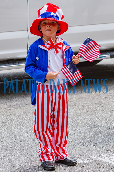 Five-year-old Dakota Hazel gives out flags as Uncle Sam during the Memorial Day parade. Fran Ruchalski/Palatka Daily News
