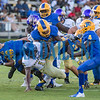 A host of Panthers defenders upend Menendez quarterback King Benford (11) in the first half of their game on Friday night. Fran Ruchalski/Palatka Daily News