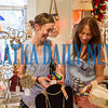 Jessica Hagen and Gail Rychlicki browse through the offerings at Christmas in July at the Palatka Art League on Friday afternoon. The event continues on Saturday 10 a.m.-4 p.m. and Sunday noon-4 p.m. Fran Ruchalski/Palatka Daily News