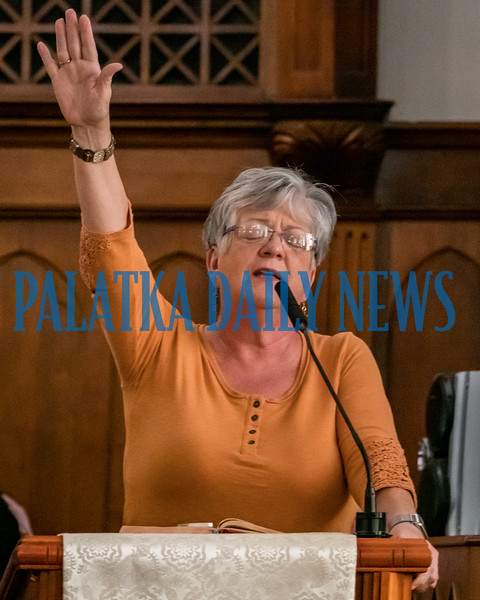 Pastor Sophia Smith of Palatka Church of God of Prophecy prays for the businesses of Putnam County during the local National Day of Prayer observance at Saint James United Methodist Church on Thursday. Fran Ruchalski/Palatka Daily News