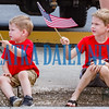 Lucas Best, 2, and Weston Best, 6, wave their flags as the Memorial Day parade goes by them on Monday morning. Fran Ruchalski/Palatka Daily News