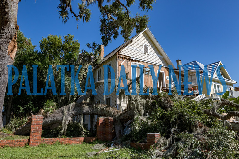 A massive rotted branch fell off the oak next door and destroyed the front of the house at 418 River Street Monday afternoon. Fran Ruchalski/Palatka Daily News