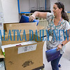 Fifth-grade teacher Becky Bennett unpacks a shipment of books for her classes at Browning-Pearce Elementary School on Tuesday morning as she gets ready for the new school year. Fran Ruchalski/Palatka Daily News