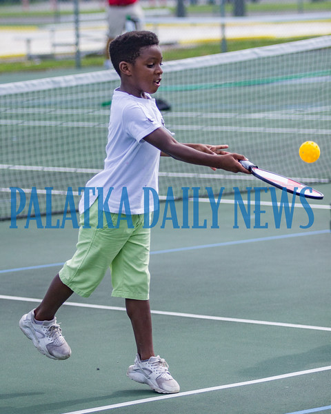 Eight-year-old Kyrin Session serves the ball during the Youth Pickleball Introductory Clinic at the John Theobold Sports Complex on Thursday morning. The clinic was one of several events Putnam County Parks & Recreation organized to celebrate Park and Recreation Month. Fran Ruchalski/Palatka Daily News