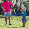 Under the watchful eye of instructor Troy Sheffield, eight-year-old Ely Watson tries his hand at putting on Tuesday morning. Fran Ruchalski/Palatka Daily News