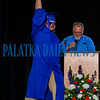 Putnam Edge graduate Nathaniel Ramos shows off his diploma as he dances off stage on Saturday afternoon. Fran Ruchalski/Palatka Daily News