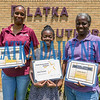 Jhane Fountain, 11, center holds a certificate for her performance in the First Annual FAHRO (Florida Association of Housing and Redevelopment Organizations) Spelling Bee at Walt Disney World while her coaches, Yvonne Jones and Lakesha Session stand with her. The Moseley Elementary fifth-grader took third place among students from across the state. Fran Ruchalski/Palatka Daily News