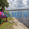Nanette Battles got the day off and decided to enjoy a peaceful and quiet day of fishing on the banks of the St. Johns River on Friday morning using an interesting set-up with no reel and Miller Lite bobbers. Fran Ruchalski/Palatka Daily News