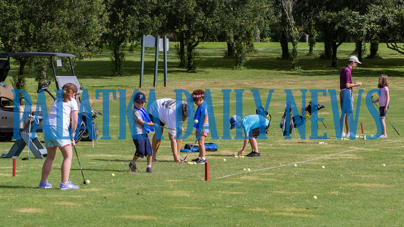 Some of the student golfers try their hand at teeing off on the driving range at the Palatka Golf Club on Tuesday morning. Fran Ruchalski/Palatka Daily News