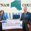 Melissa Nelson, president of United Way of St. Johns County and chairman of the Board of Directors, Bobby Crum present a check for hurricane relief to Putnam County residents in the amount of $55,132 at a press conference on Wednesday morning. Fran Ruchalski/Palatka Daily News