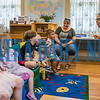 Librarian Lora Arrington energetically reads a book with the kids at the Infant & Toddler Storytime at the Bostwick Library on Thursday afternoon. Pictured with Arrington from left are Emilee Myers, 7, Charlotte Myers, 4, Noah Myers, 5, Braylee Perish, 2, Johnn Lusk, 2, and Wendy Lusk. Fran Ruchalski/Palatka Daily News