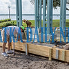 Workers get ready to pour concrete around the base of the recently replaced Clock Tower along the riverfront on Monday morning. Palatka Daily News