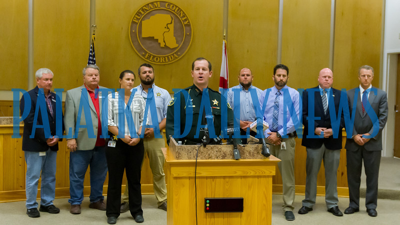 Surrounded by county officials and law enforcement personnel, Putnam County Sheriff Gator DeLoach talks about a bank card skimming operation that was recently cracked in Putnam, Duval, Clay and other counties. Fran Ruchalski/Palatka Daily News