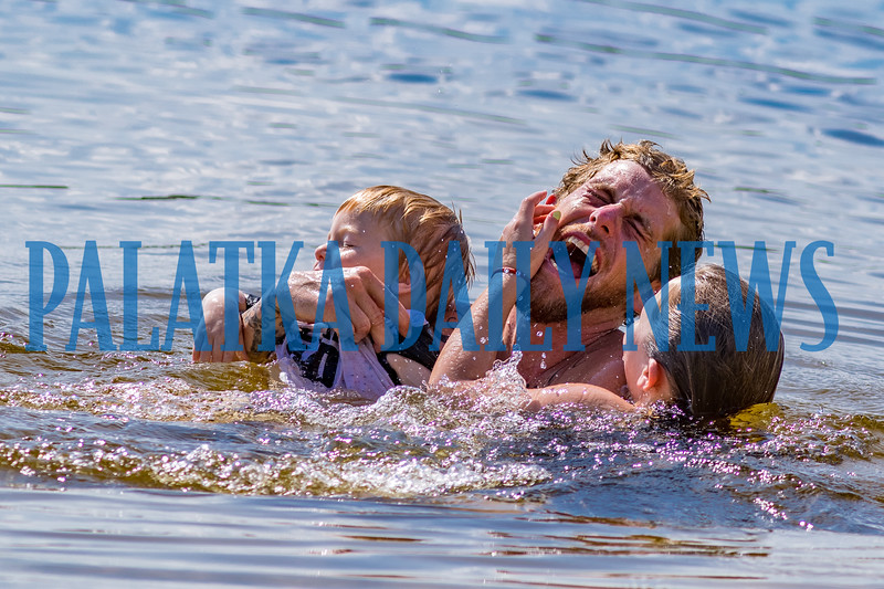 Braysen Abby, 2, from left, Mike Stoltz and Chloe Polgar, 9, enjoy a fun family swim in Lake Stella in Crescent City on Monday afternoon. Fran Ruchalski/Palatka Daily News