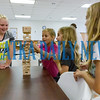 Lucille Strickland, 9, (in pink) contemplates a move in a game of Jenga as Makenna Harrell, 9, Peyton Strickland, 9, and Harley Strickland, 9, get a little worried about the outcome at the 4H Fit 4 Life day camp. Fran Ruchalski/Palatka Daily News