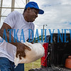 Roosevelt Lewis loads a sandbag he's just filled into his pickup Friday morning. Fran Ruchalski/Palatka Daily News