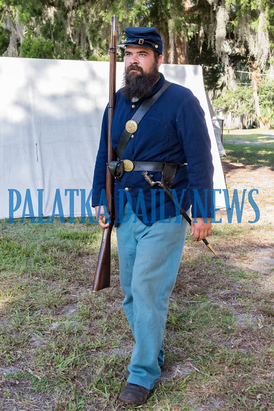 A Yankee soldier marches across the front lawn of the Bronson-Mulholland House at Occupation Palatka on Saturday morning. Fran Ruchalski/Palatka Daily News
