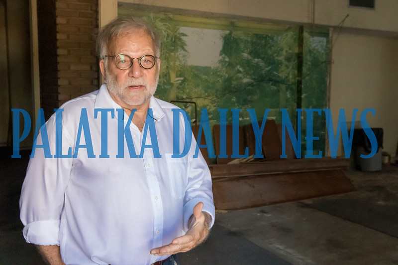 Tate Miller stands in the lobby of the Hotel James talking about the building's history and plans for the complete restoration of the hotel. Fran Ruchalski/Palatka Daily News