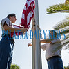 Tristan Pogue, left, and Caleb Bryan of the combined Palatka/Interlachen ROTC Honor Guard raise the flag to half staff at the county office complex for the Putnam County Remembrance Ceremony in honor of the 18th anniversary of 9/11/2001 on Wednesday morning. Fran Ruchalski/Palatka Daily News
