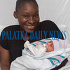 Kymara Boyd holds her day-old son Joziah William Fuller at Putnam Community Medical Center Wednesday afternoon. Fran Ruchalski/Palatka Daily News