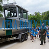 Putnam County Sheriffs Office school resource officer and marine unit deputy Joseph Abbott walks daycampers at Camp Shands around the marine unit as he shows them the features of the boat. Fran Ruchalski/Palatka Daily News